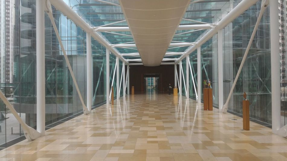 Absence Architectural Column Architectural Feature Architecture Building Built Structure City Corridor Day Diminishing Perspective Empty Flooring Modern Narrow No People Repetition The Way Forward Tile Vanishing Point Walkway