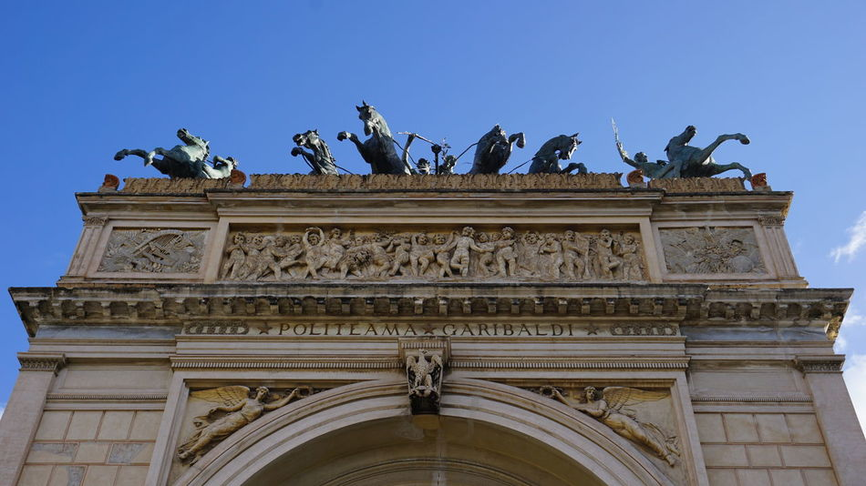 Politeama Theater. Detail of the horses sculptures on the theater's roof. Piazza Politeama, Palermo, Sicily, Italy. Palermo Sicily Italy Sony A6000 Sony Travel Destinations Sonyalpha Photographer Travel Street Streetphotography Photo Vacation Vacations Architecture_collection Photography Politeama Horse Sculpture Horses Politeama Theatre Palermo Sicilia Italia Architectural Detail Architecture City Sculpture Statue Bas Relief History Clear Sky Cultures Decorative Art Neo-classical