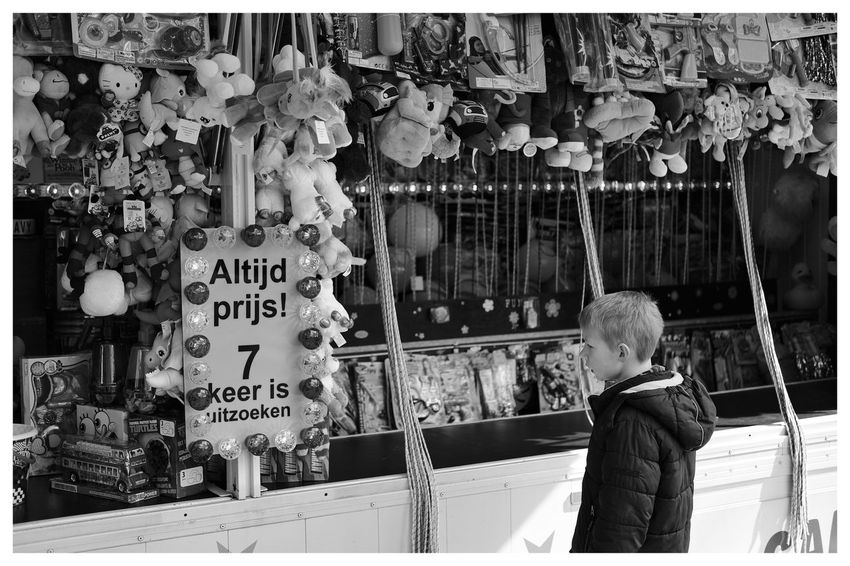 """Winning guaranteed"" Streetphotography Fair Kids Kids Being Kids Toys Entertainment Blackandwhite Blackandwhite Photography Blackandwhitephotography Black And White Black And White Photography EyeEm Best Shots - Black + White"
