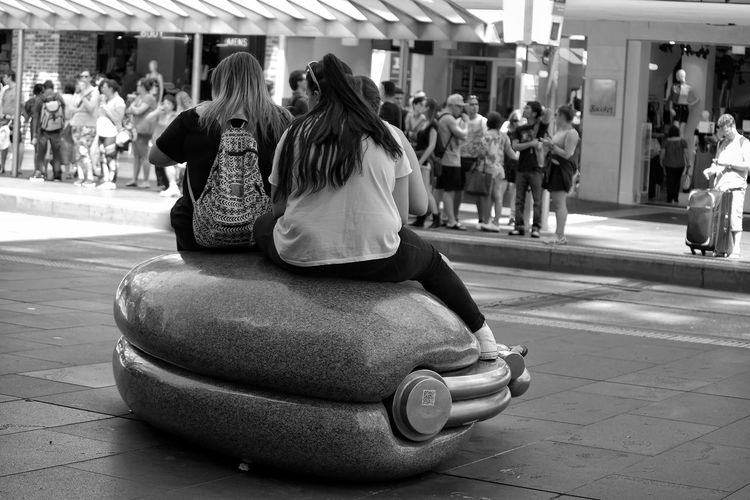 Sitting Outdoors People Day People Watching Melbourne City Casual Clothing Street Photography Monochrome Black And White People Photography Street Life Real People City Friendship Street Enjoyment Togetherness Young Women Full Length Candidly Human Sitting Full Length The City Light Spontaneous Welcome To Black