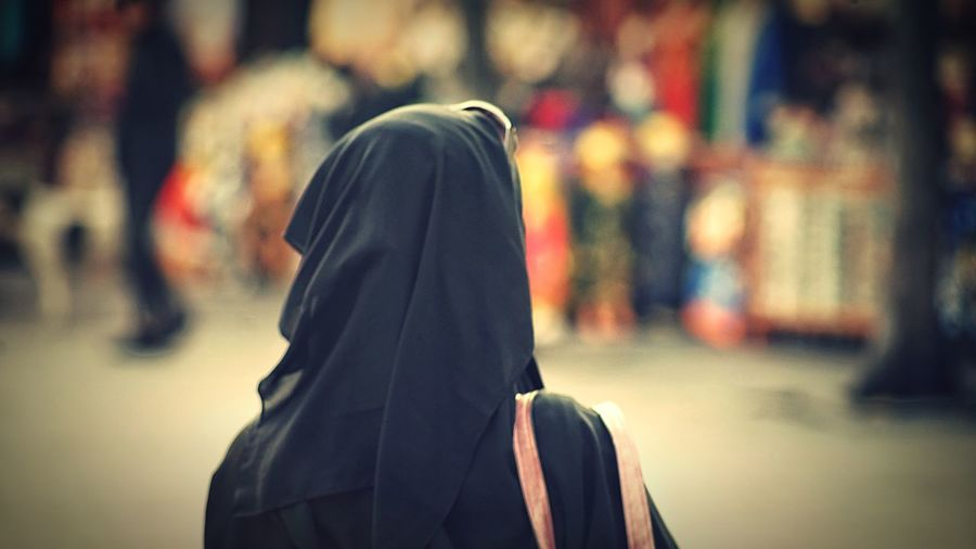 Rear view of woman wearing hijab in city