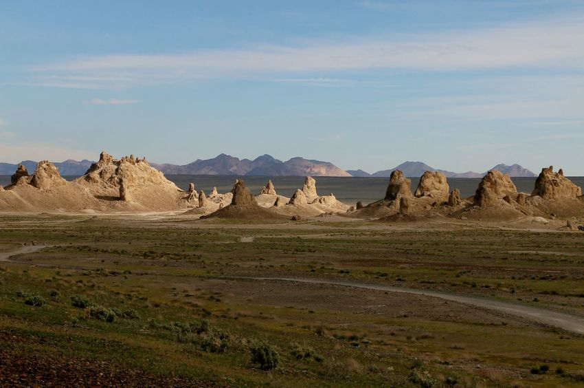Desert Lost In The Landscape Arid Climate Beauty In Nature Day Grass Landscape Mountain Nature No People Outdoors Physical Geography Scenics Sky Sunset Tranquil Scene Tranquility Trona Pinnacles An Eye For Travel