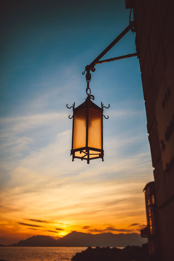 Lamp on the front of beautiful sunse Day Hanging Low Angle View Nature No People Outdoors Pulley Sky Sunset