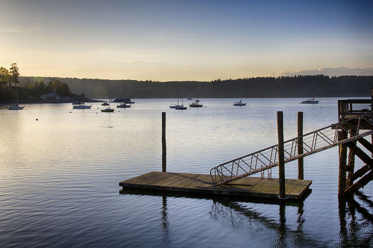 View of boats and dock in lake