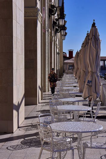 Architecture City Travel Destinations Outdoors History Built Structure No People Day Sky Umbrellas Tables And Chairs Columns Empty Restaurant Good Morning One Person Eating Out Getting Warmer Sunnnyday