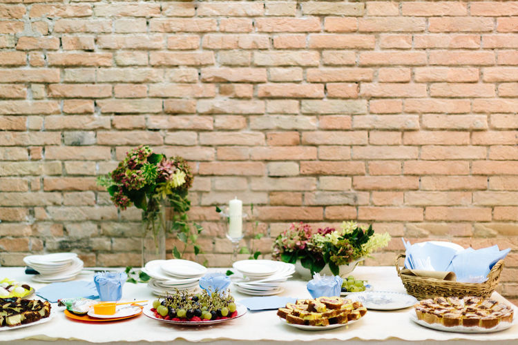 Bowl Breakfast Brick Wall Cake Day Feast Flower Food Food And Drink Freshness Healthy Eating Indoors  No People Party Time Place Setting Plate Ready-to-eat Saucer Table Table Setting Tablecloth Tea - Hot Drink Teapot Vase Visual Feast Food Stories