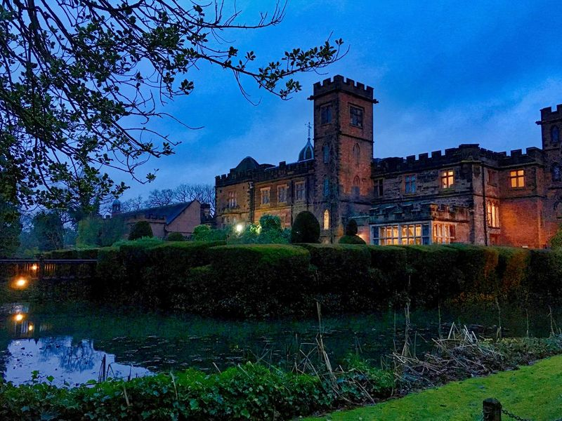 Rear view of the building at dusk Historical Building New Hall Hotel Water Reflections Architecture Beauty In Nature Building Exterior Built Structure Cloud - Sky Moat Nature New Hall Night No People Outdoors Reflections Reflections In The Water Sky Tower Tree Water