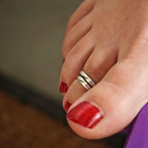 Close-up of woman foot with nail polish and ring