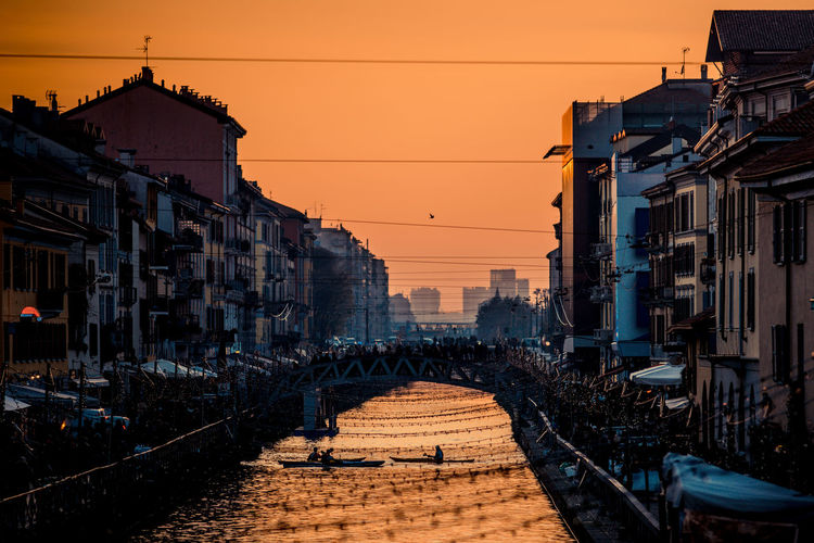 Sporty people have fun with canoe at navigli milano italy - winter xmas time