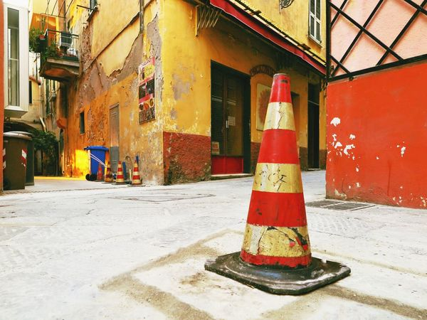 Alassio City Mark Sign Architecture Building Building Exterior Building Site Built Structure Day Italy No People Old Buildings Outdoors Red White Safety Selective Focus Separated Separation Street Photography Streetphotography Traffic Cone Warning Warning Sign