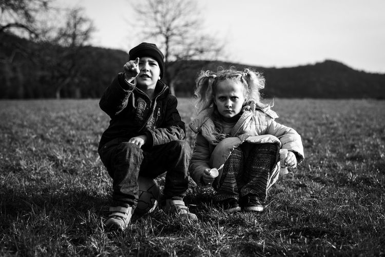Why so serious?! Black & White Black And White Blackandwhite Boy Cheerful Child Childhood Children Only Day Friendship Full Length Girl Grass Nature Outdoors People Sitting Togetherness Two People