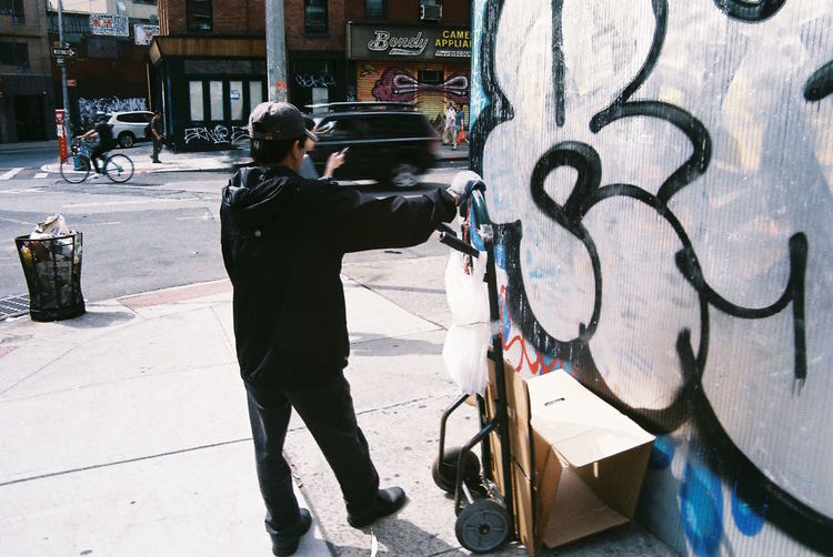 Graff NYC New York New York City Adult Architecture Built Structure Car Day Full Length Graffiti Art Land Vehicle Lifestyles Men One Person Outdoors People Real People Standing Street Photography Transportation Trolley Cart Walking