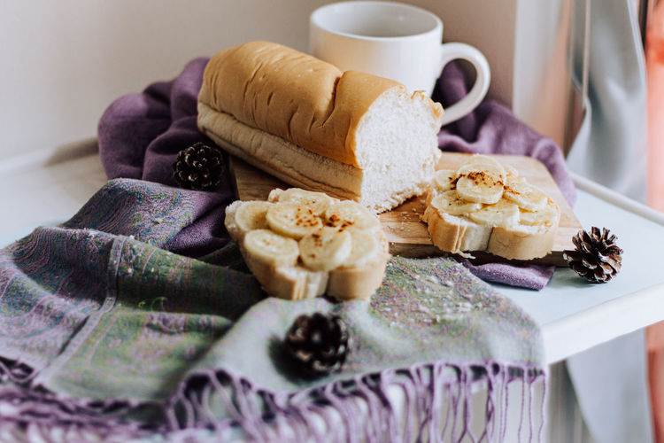 Close-up of coffee and bread on table