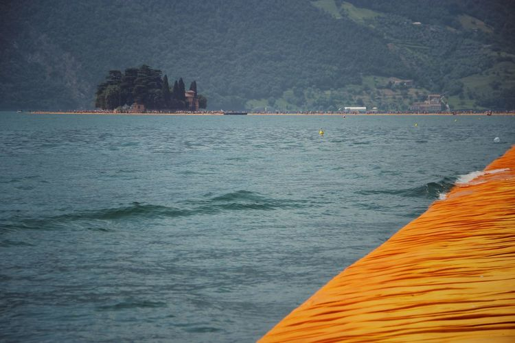 Walking on the Floating piers | Original Experiences Lake Fine Art Still Life The Floating Piers Edge Of Imagination Getting Inspired The Essence Of Summer Close-up Christo And The Floating Piers Feel The Journey Sunshine Tailored To You Point Of View 43 Golden Moments Showcase July Golden Moments  Lago D'Iseo EyeEm Italy |
