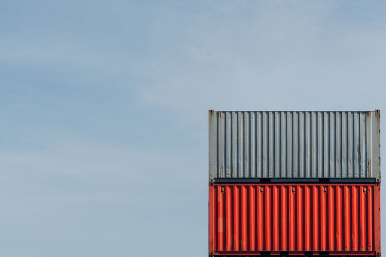 Low angle view of red container against sky
