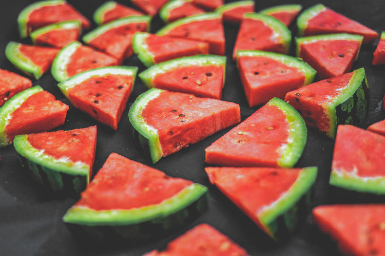 High angle view of fresh chopped watermelon pieces on table