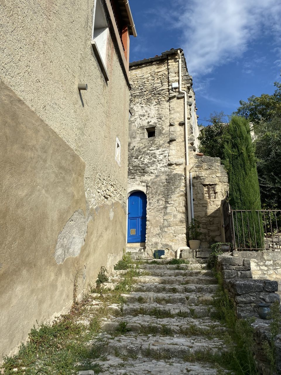 architecture, built structure, building exterior, building, staircase, the way forward, nature, no people, sky, direction, day, plant, sunlight, wall, history, low angle view, the past, house, window, cloud - sky, outdoors, stone wall