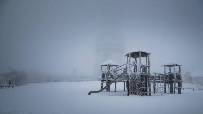 Architecture Building Exterior Built Structure Clear Sky Cold Cold Days Cold Temperature Coldweather Copy Space Dust Fog Foggy Day Frozen Frozen Nature Low Angle View Mountain Playground Playgrounds Studio Shot Text Tower Weather White Background It's Cold Outside