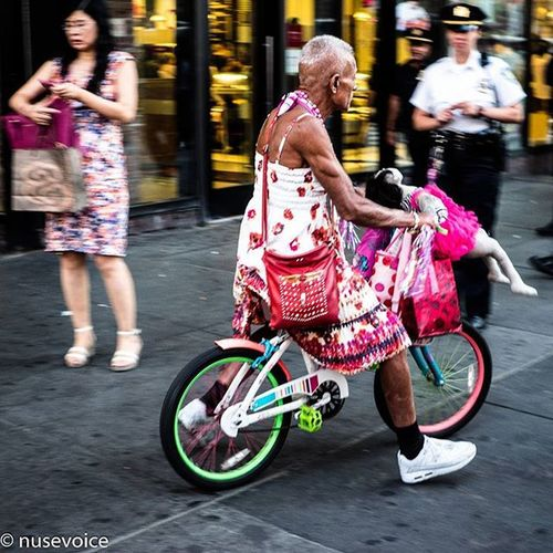 Don't even ask • September 2015 Nusevoice Olympusomdem1 Zuikodigital Instagoodmyphotos instagram wsp instagoodmyphoto instagood instagrammersgallery streetphotography streetscenes man indrag bicycle colorful nyscenes people fun timessquarenyc manhattan NYC photoofthedayphoto photo doll dress