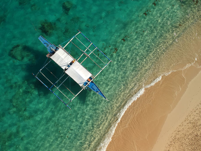 High Angle View Of Boat On Sea At Beach