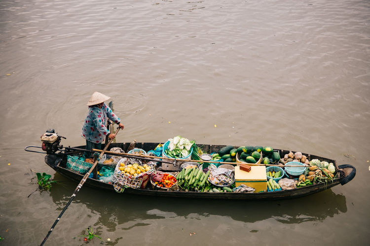 High angle view of man with vegetables in boat