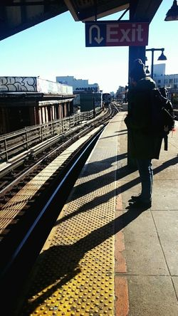 waiting for the train ft. a stranger Train NYC Graffiti Dirty Sun Platform Brooklyn Morning Finalsweek Yellow Newyork EyeEm Outside Subway Winter