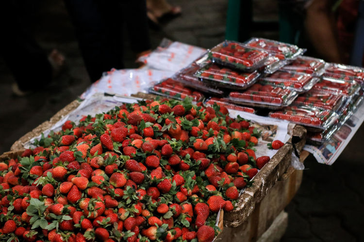 Abundance Business Choice Container Day Focus On Foreground Food Food And Drink For Sale Freshness Fruit Healthy Eating Incidental People Large Group Of Objects Market Market Stall One Person Red Retail  Retail Display Ripe Sale Small Business