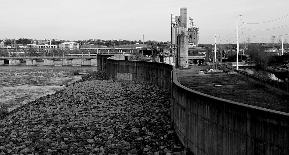 Flood wall south of the James River in Richmond, Virginia 2catswithcameras Eyem Black And White Snaking Architecture Building Exterior Built Structure City Day Flood Wall Industry No People Outdoors Pjpink River Sky Transportation Water