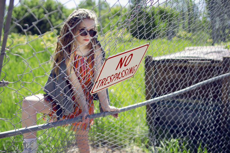 Fashion Girl Power Photoshoot Portrait Of A Woman SexyGirl.♥ Adult Adults Only Chainlink Fence Day Dreadlocks Fashion&love&beauty Female Model One Person One Woman Only One Young Woman Only Outdoors People Portrait Sexygirl Sexywomen Sunglasses Text Urban Young Adult Young Women