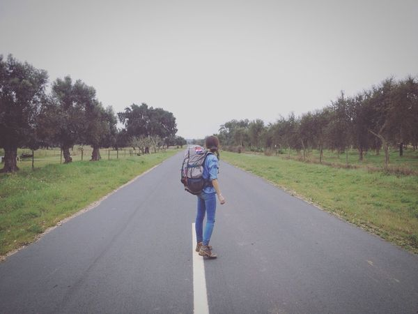 Start your journey Full Length One Person Real People Tree Travel Lady Casual Clothing Lifestyles Road Nature Day Rear View The Way Forward Growth Outdoors Grass Beauty In Nature Young Adult Sky People