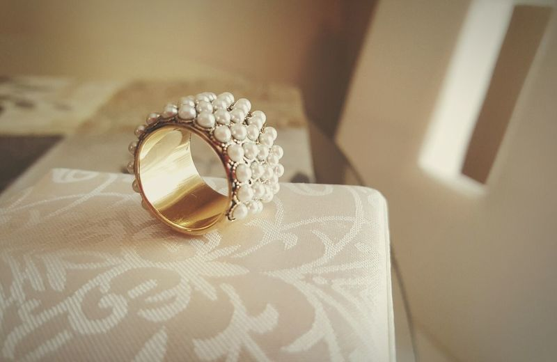 Close-up of pearl bangle on table at home