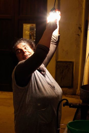 One Person Standing Lifestyles Illuminated Real People People Adult Human Body Part Human Hand Night Streetfood Maria Delle Sgagliozze Bari Barivecchia Friedfood Food Puglia Italy Old Light And Shadow Lightbulb Gesture Smile Streetphotography Snap A Stranger
