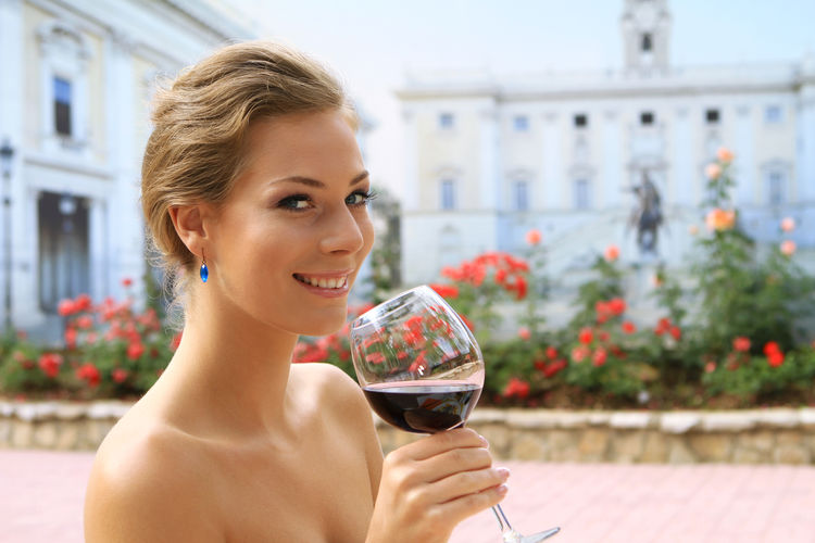 young woman drinking a glass of red wine on holiday Happiness Red Wine Woman Beauty Cheers Close-up Drink Drinking Female Girl Gorgeous Headshot Leisure Leisure Activity One Person Outdoors Portrait Pretty Vacation Young Adult Young Women