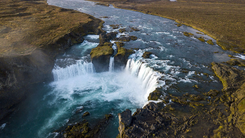 The Goðafoss is a waterfall in Iceland. It is located in the Bárðardalur district of Northeastern Region at the beginning of the Sprengisandur highland road. The water of the river Skjálfandafljót falls from a height of 12 meters over a width of 30 meters. Scenics - Nature Water Beauty In Nature Waterfall Motion Long Exposure Nature Flowing Water No People Outdoors Power In Nature Flowing Goðafoss Waterfall Sunrise Sunset Rock Rock - Object High Angle View Land Day Aerial View Dronephotography Iceland North Iceland Sea Solid Sport Power Environment Breaking