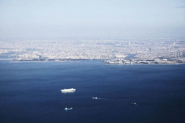 Calmness Tokyo Aerial View Architecture Blue Building Exterior Built Structure Calm Water City Cityscape Day High Angle View Mode Of Transportation Nature Nautical Vessel No People Outdoors Scenics - Nature Sea Sky Transportation Water Waterfront