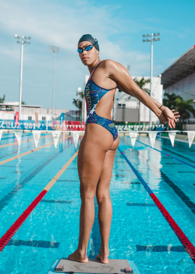 Athlete Blue Casual Clothing Competition Confidence  Day Enjoyment Full Length Hapiness Joy Leisure Activity Lifestyles Olympic Outdoors Passion Portrait Skill  Sky Sports Sports Photography Sunlight Swimming Swimming Pool Trust Vacations