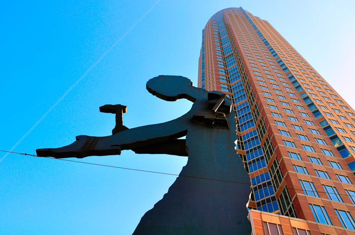 Hammering Man - Messe (Fair) Frankfurt am Main Architecture Black Metal City Clear Blue Sky Clear Sky Day Fair Frankfurt Am Main Hammeringman Himmel Lookingup Low Angle View Messe Messetower Messetowerfrankfurt Messeturm No People Outdoors Perspective Perspective Changes Everything Perspective Photography Perspectives And Dimensions Sky Skyscraper View