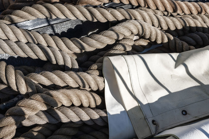 Sailing Ship Backgrounds Choice Close-up Day Full Frame High Angle View Large Group Of Objects No People Pattern Rope Ropes Sail Sailboat Sailboats Sailing Shadow Still Life Strength Sunlight Textile Textured  Tied Up Variation White