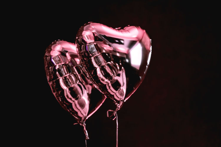 Celebration Emotions Happiness Reflection Shiny Balloon Black Background Close-up Copy Space Decoration Design Emotion Glass - Material Heart Shape Indoors  Love Marriage  No People Pink Color Positive Emotion Silver Colored Still Life Studio Shot Two Objects Valentine's Day - Holiday