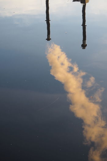 Reflection Of Smoke Stack On Lake