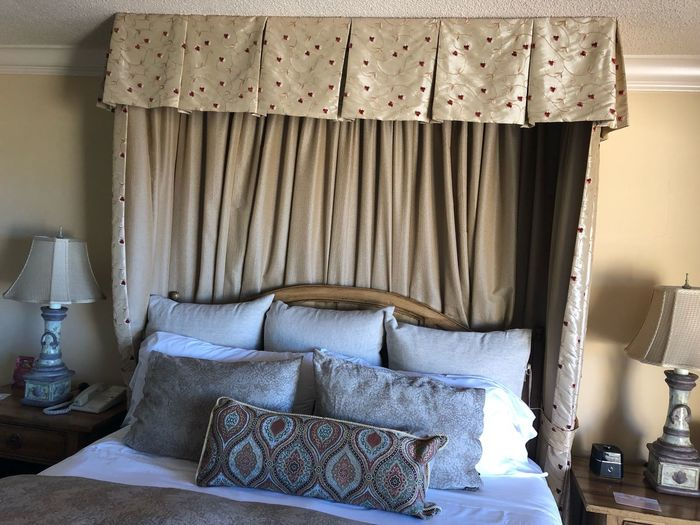 Furniture Indoors  Domestic Room Home Interior Pillow Bed No People Bedroom Sofa Curtain Comfortable Cushion Stuffed Pattern Architecture House Home Wall - Building Feature Day Textile