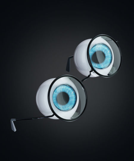 Low angle view of electric lamp against black background