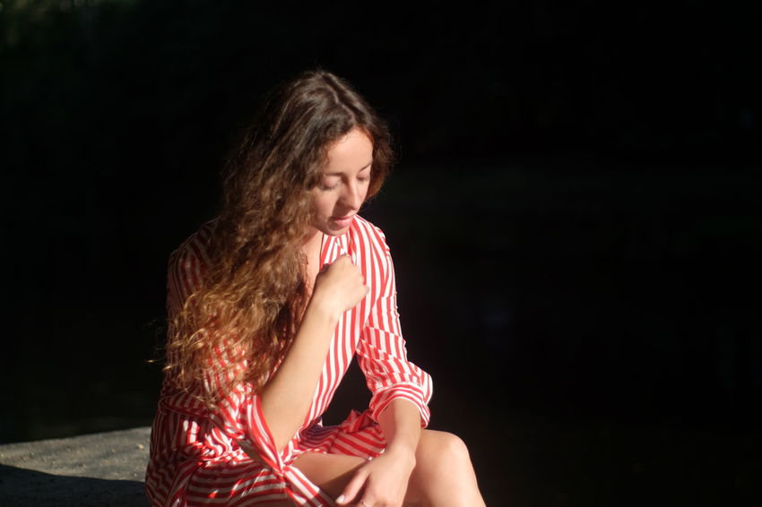 Summer by the river Black Background Brown Hair Casual Clothing Child Childhood Contemplation Copy Space Emotion Hair Hairstyle Leisure Activity Long Hair Looking One Person Sitting Striped Teenager Three Quarter Length Waist Up Women Young Adult