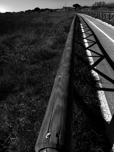 Walk away Street Huaweiphotography Geometry Blancoynegro Blackandwhite Photography Land Bnw Photography Bnw_captures Photographing So Far, So Close Pathway Walking Around Taking Pictures Geometric Lines Shadows Long Shadow - Shadow The Art Of Street Photography Empty Road The Way Forward White Line