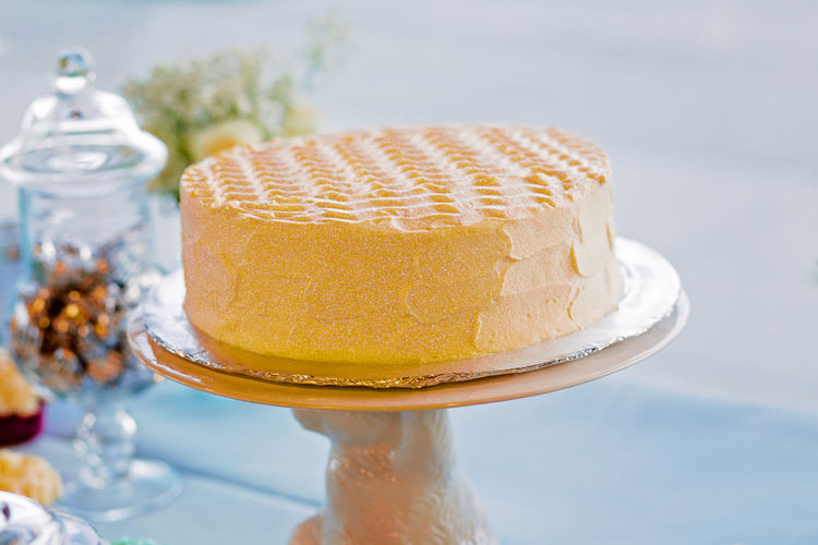 Close-up of buttercream cake on table