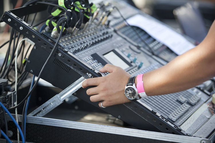 Cropped hand of person playing dj