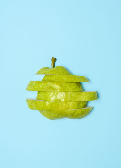 Close-up of apple against blue background