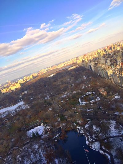 Manhattan, New York City, New York. An aerial view of Central Park. Central Park - NYC Central Park New York City Urban Skyline High Angle View Shadows & Lights Winter Cityscape No People Cloud - Sky Aerial View Landscape Architecture Daylight City Life USA Water Morning Light Scenics - Nature Copy Space Manhattan Skyscraper Financial District  Hudson River Shadow