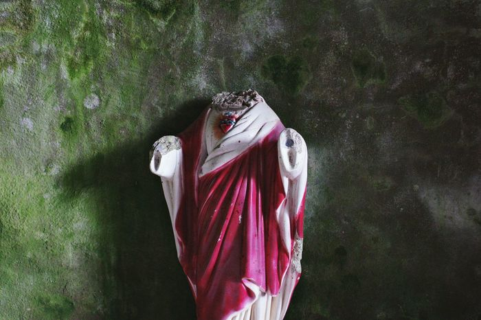 broken heart. Close-up Red Fragility Cemetery Statue Broken Statue Religious Icons Monument Decay Green Damaged Bleeding Heart  Jesus