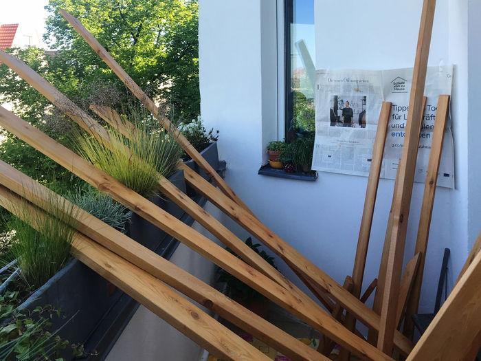 Tilt image of chair in yard seen through window